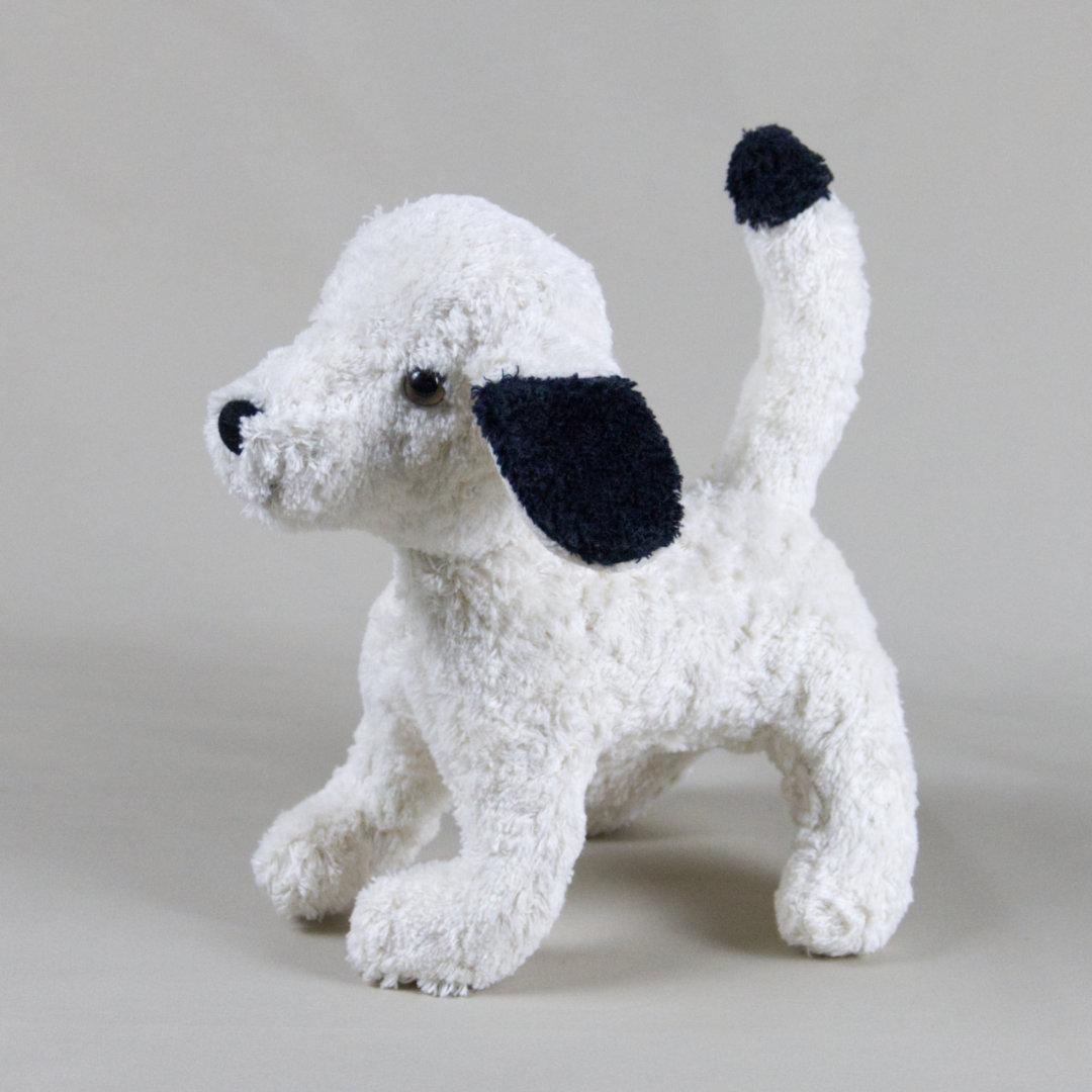 Selbststehender Stofftier-Hund mit schwarz-weißem Fell