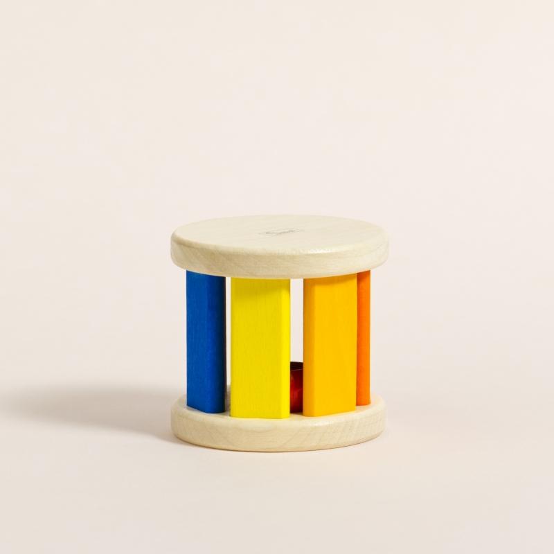 Klangrolle aus Ahornholz mit bunt gefärbten Stäben in verschiedenen Farben von Rot bis Gelb zu Blau und Lila